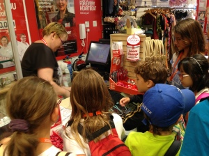 The students used English from their lessons to ask some questions in the shops.