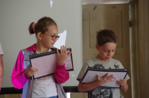 Milena and Vova giving their presentations about their monsters.