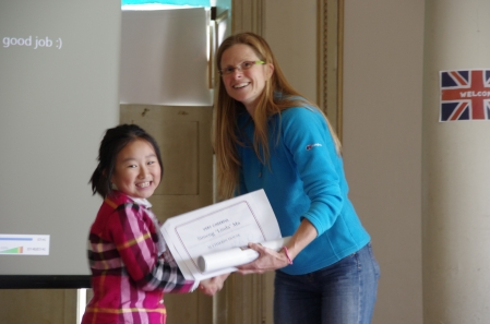 The students all received a certificate and an award. Here's Linda and her teacher, Jacci.