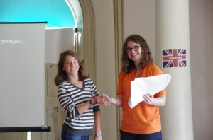 The students all received a certificate and an award. Here's Reby and her teacher, Freya.