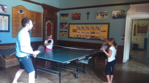 Martina, Benny and Mati playing table tennis with Dave.