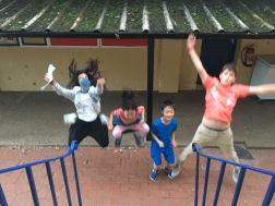 Four people doing star jumps